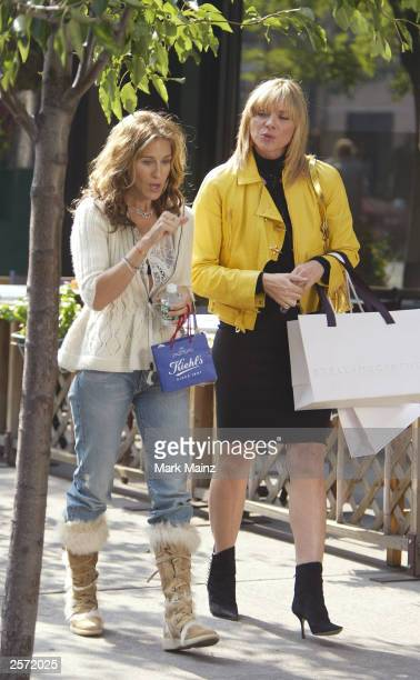 Actress Sarah Jessica Parker and Kim Cattrall rehearses a scene on the set of the hit HBO series 'Sex and the City' October 8 2003 in New York City