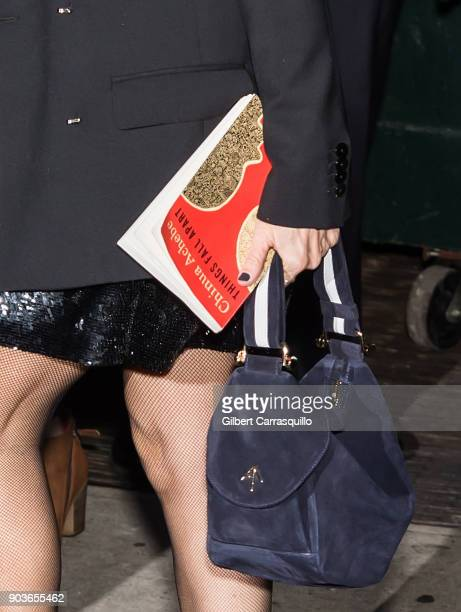 Actress Sarah Jessica Parker handbag and book detail is seen arriving to 'The Late Show With Stephen Colbert' at the Ed Sullivan Theater on January...