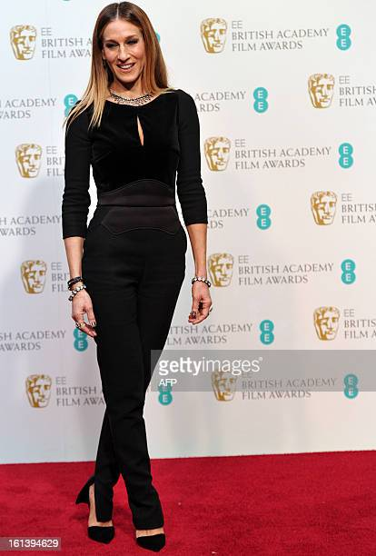 US actress Sarah Jessica Parker poses for photographs during the annual BAFTA British Academy Film Awards at the Royal Opera House in London on...