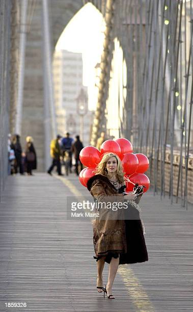 Actress Sarah Jessica Parker shoots a promotional video for the hit HBO series 'Sex and the City' on Brooklyn Bridge March 19 2003 in New York City