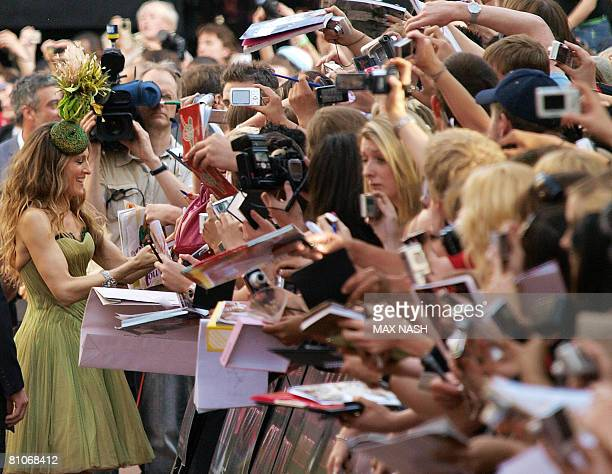 US actress Sarah Jessica Parker signs autographs as she arrives in London's Leicester Square on May 12 to attend the World Premiere of her latest...