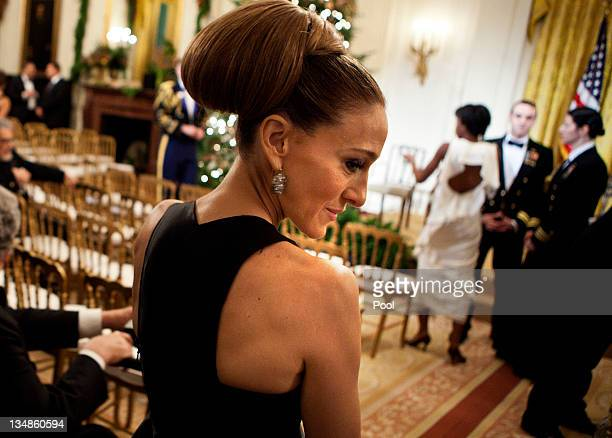 Actress Sarah Jessica Parker waits to be seated for a Kennedy Center Honors reception in the East Room of the White House on December 4 2011in...