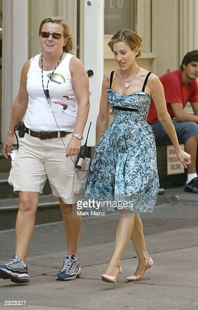 Actress Sarah Jessica Parker walks on the set of the hit HBO series 'Sex and the City' July 29 2003 in SoHo New York City