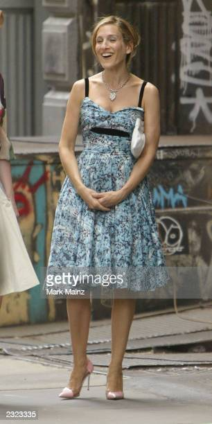 Actress Sarah Jessica Parker walks while on the set of the hit HBO series Sex and the City July 29 2003 in SoHo New York City