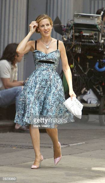 Actress Sarah Jessica Parker walks while on the set of the hit HBO series 'Sex and the City' July 29 2003 in SoHo New York City