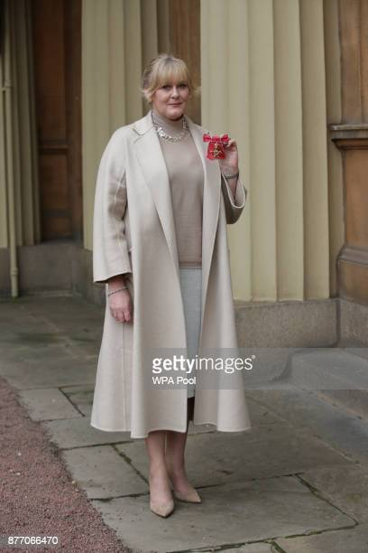 Actress Sarah Lancashire poses after she was awarded an OBE by Duke of Cambridge during an Investiture ceremony at Buckingham Palace on November 21...
