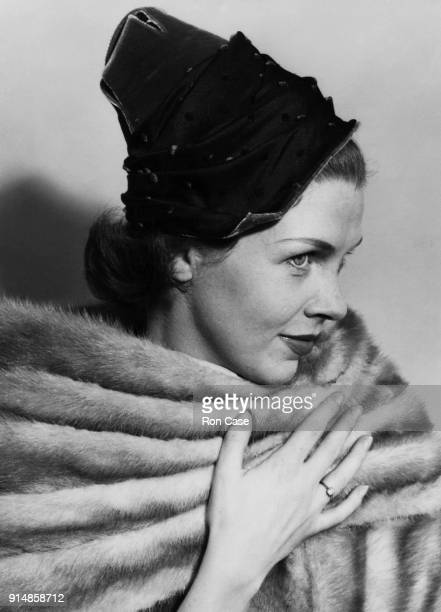 Actress Sarah Lawson models 'Everest Line' a black taffeta hat with pink and red velvet spots by Dolores of London 1st September 1953