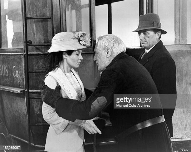 Actress Sarah Miles actors Trevor Howard and Robert Mitchum on set of the MetroGoldwynMayer movie Ryan's Daughter in 1970