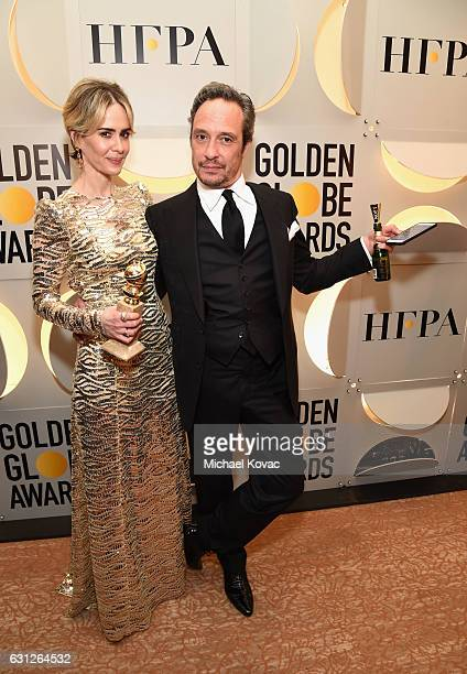 Actress Sarah Paulson and producer D V DeVincentis attend the 74th Annual Golden Globe Awards at The Beverly Hilton Hotel on January 8 2017 in...