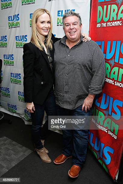Actress Sarah Paulson poses with host Elvis Duran during a visit to the Elvis Duran Z100 Morning Show at Z100 Studio on December 6 2013 in New York...