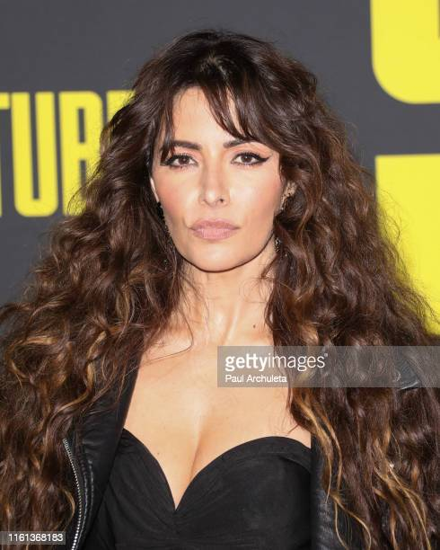 Actress Sarah Shahi attends the premiere of 20th Century Fox's Stuber at Regal Cinemas LA Live on July 10 2019 in Los Angeles California