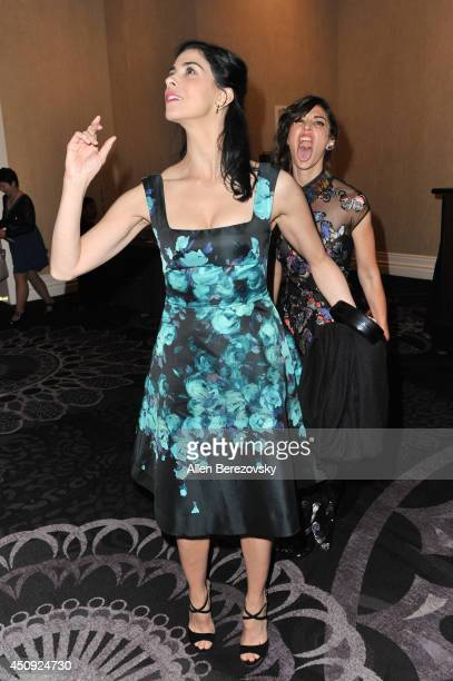 Actress Sarah Silverman gets photobombed by actress Lizzy Caplan at the 4th Annual Critics' Choice Television Awards at The Beverly Hilton Hotel on...