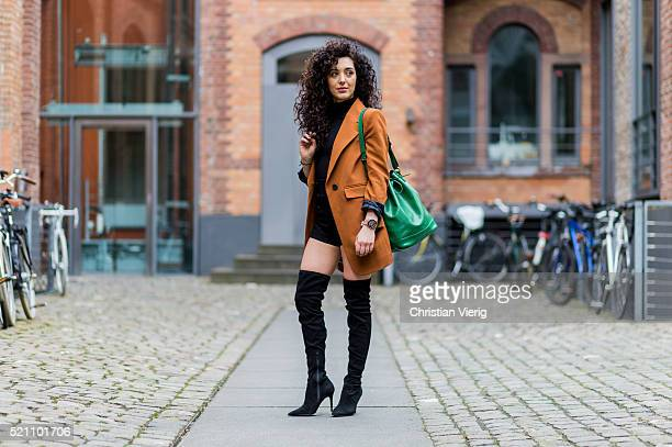 Actress SaraJoleen Kaveh Moghaddam wearing a bronze HM blazer a black American Apparel top black Missguided shorts black Asos overknees and a green...