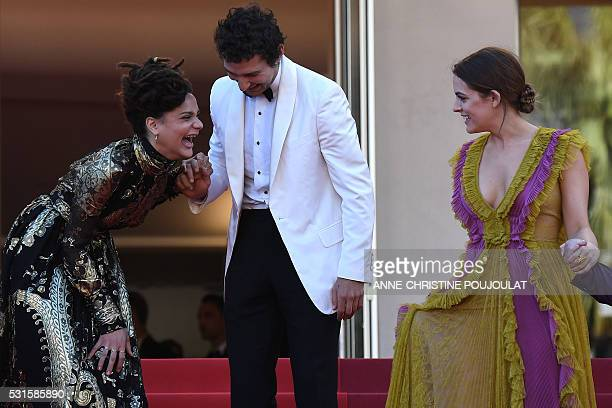 US actress Sasha Lane laughs with US actor Shia Labeouf and US actress Riley Keough as they leave the Festival Palace on May 15 2016 after the...
