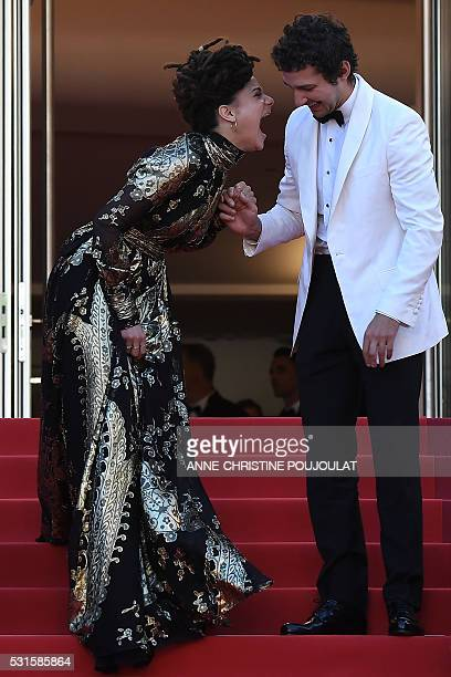 US actress Sasha Lane laughs with US actor Shia Labeouf as they leave the Festival Palace on May 15 2016 after the screening of the film American...