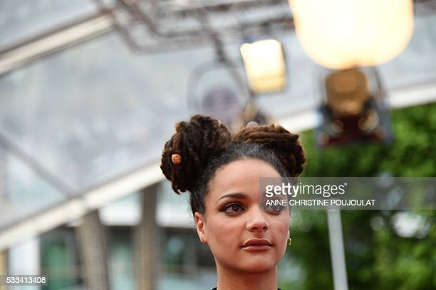 US actress Sasha Lane poses as she arrives on May 22 2016 for the closing ceremony of the 69th Cannes Film Festival in Cannes southern France / AFP /...