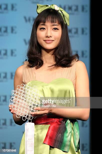 Actress Satomi Ishihara is presented an award during the 'Vogue Nippon Women of the Year 2010' award ceremony at Grand Hyatt Tokyo on November 22...