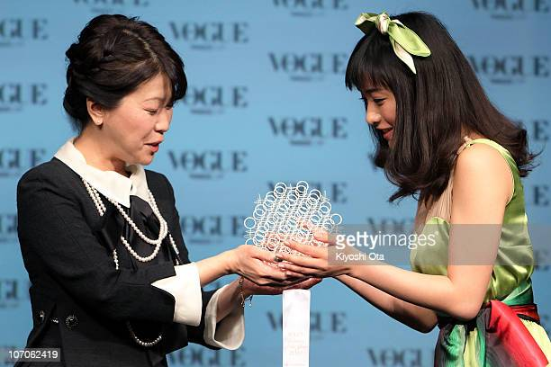Actress Satomi Ishihara receives an award from Vogue Nippon Editor in Chief Mitsuko Watanabe during the 'Vogue Nippon Women of the Year 2010' award...