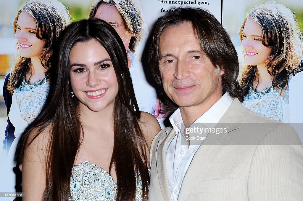 Actress Savannah Lathem and actor Robert Carlyle arrive at 'California Solo' Los Angeles premiere at the Nuart Theatre on December 7, 2012 in West Los Angeles, California.
