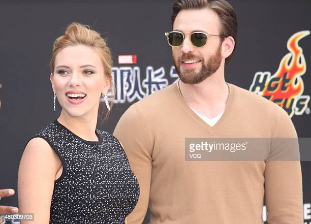 Actress Scarlett Johansson and actor Chris Evans attend Captain America The Winter Soldier premiere at Taikoo Li Sanlitun on March 24 2014 in Beijing...