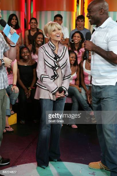 Actress Scarlett Johansson and actor Michael Clarke Duncan appear onstage during MTV's Total Request Live at MTV Studios July 11 2005 in New York City