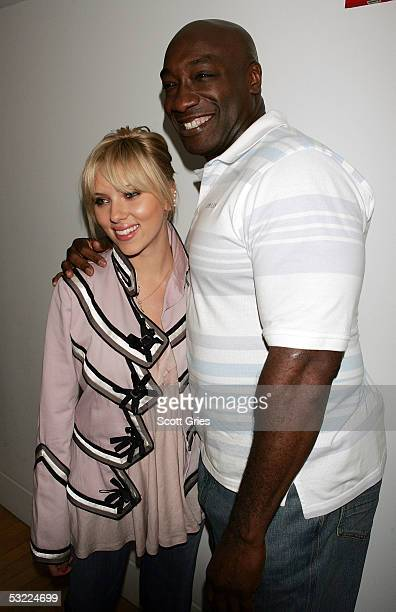 Actress Scarlett Johansson and actor Michael Clarke Duncan poses for a photo backstage during MTV's Total Request Live at MTV Studios July 11 2005 in...