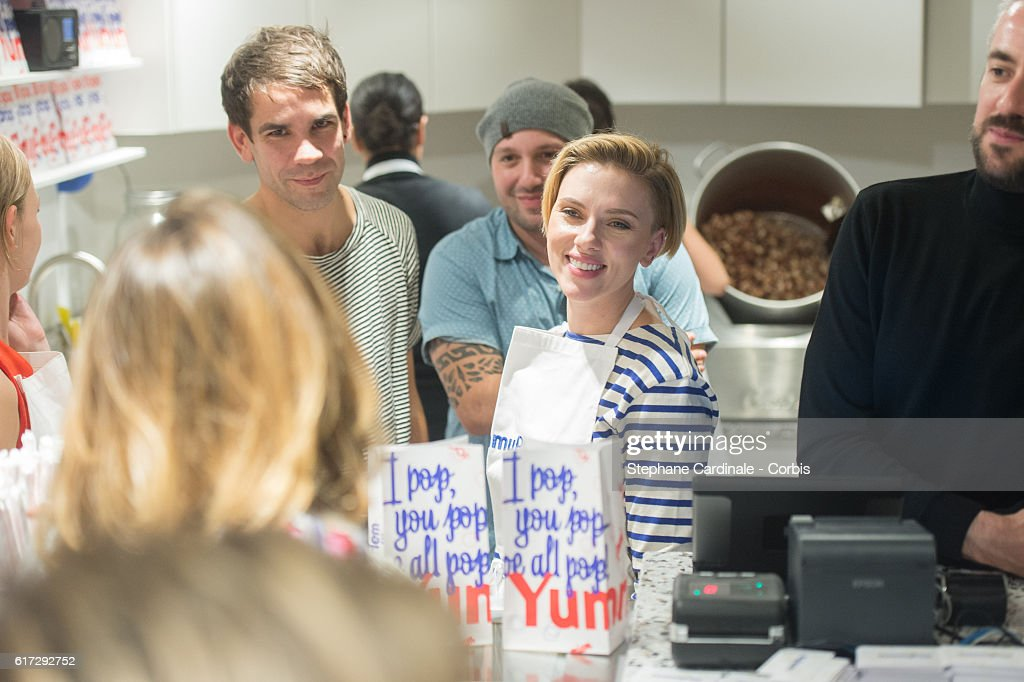 Actress Scarlett Johansson (R) and her husband Romain Dauriac attend the Opening of their New Store 'Yummy Pop', on October 22, 2016 in Paris, France.