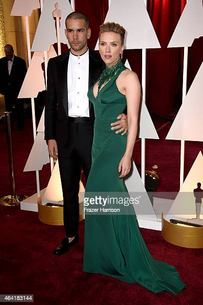 Actress Scarlett Johansson and journalist Romain Dauriac attend the 87th Annual Academy Awards at Hollywood Highland Center on February 22 2015 in...