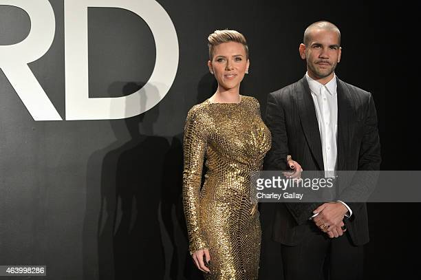 Actress Scarlett Johansson and journalist Romain Dauriac both wearing TOM FORD attend the TOM FORD Autumn/Winter 2015 Womenswear Collection...