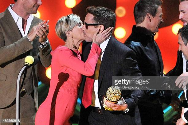 Actress Scarlett Johansson and Robert Downey Jr kiss onstage during The 2015 MTV Movie Awards at Nokia Theatre LA Live on April 12 2015 in Los...