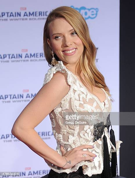 """Actress Scarlett Johansson arrives at the Los Angeles premiere of """"Captain America: The Winter Soldier"""" at the El Capitan Theatre on March 13, 2014..."""