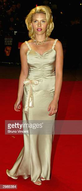 Actress Scarlett Johansson arrives at the 'The Orange British Academy Film Awards' at The Odeon Leicester Square on February 15 2004 in London...