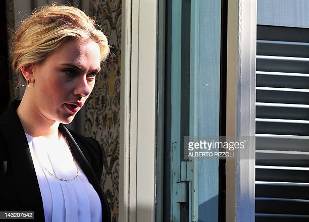 """Actress Scarlett Johansson arrives for the photocall of """"The Avengers"""" on April 21, 2012 in Rome. """"The Avengers"""" is directed by US Joss Whedon. AFP..."""