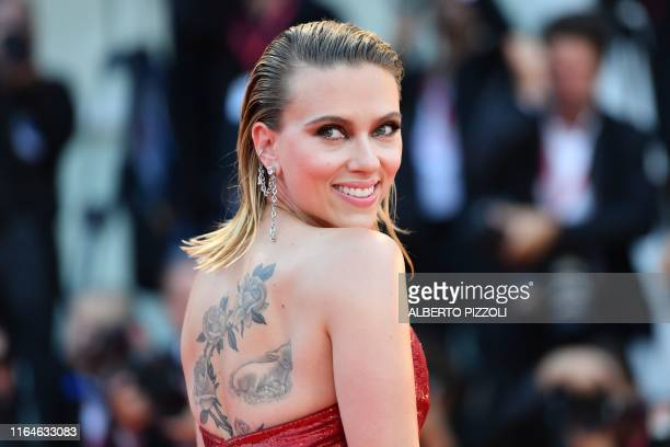 """Actress Scarlett Johansson arrives on August 29, 2019 for the screening of the film """"Marriage Story"""" during the 76th Venice Film Festival at Venice..."""