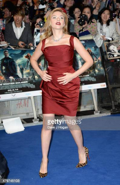 """Actress Scarlett Johansson attends the """"Captain America: The Winter Soldier"""" UK film premiere at Westfield on March 20, 2014 in London, England."""