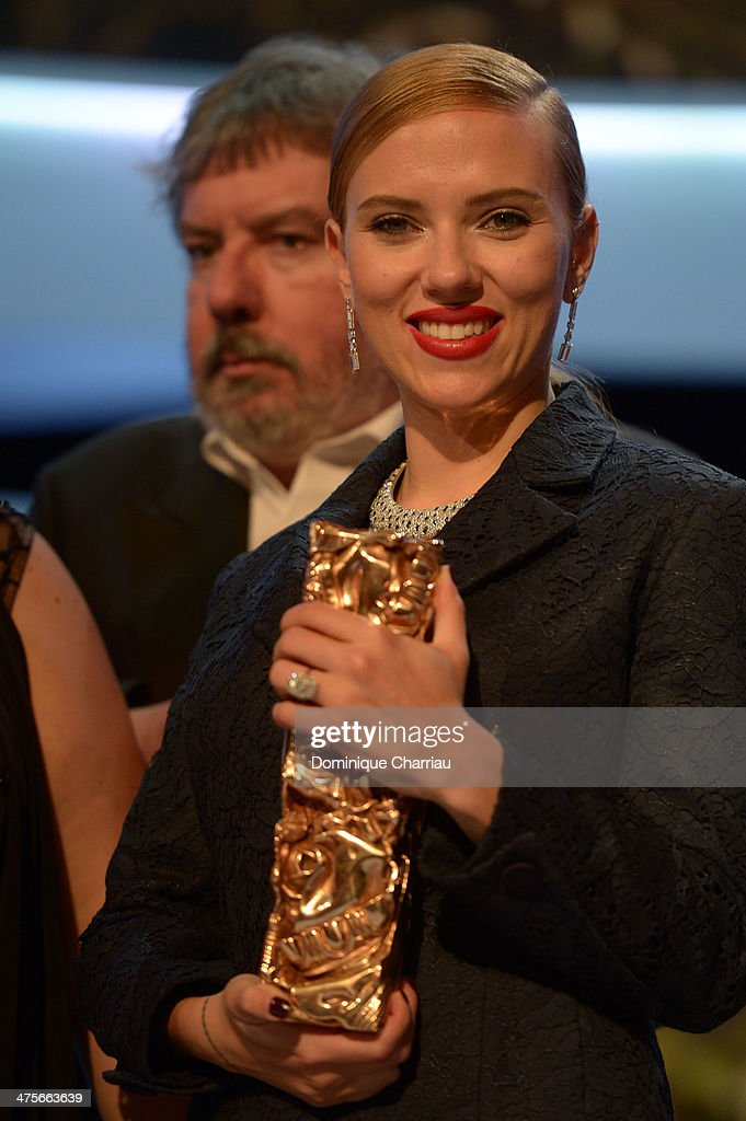 Actress Scarlett Johansson holds the Honorary Cesar on stage during the 39th Cesar Film Awards 2014 at Theatre du Chatelet on February 28, 2014 in Paris, France.