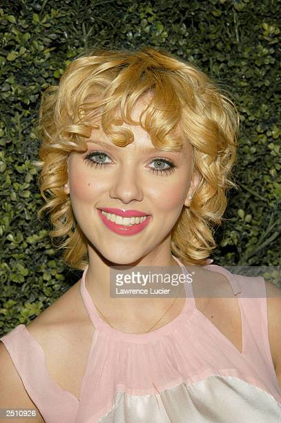 Actress Scarlett Johansson poses backstage during the Cynthia Rowley Spring/Summer 2004 Collection fashion show at the Elizabeth Street Garden on...