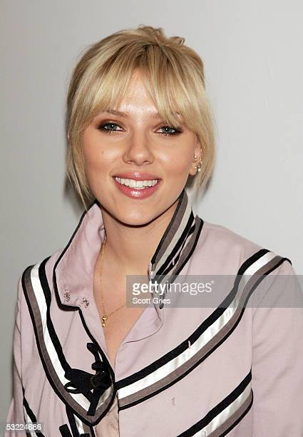 Actress Scarlett Johansson poses for a photo backstage during MTV's Total Request Live at MTV Studios July 11 2005 in New York City