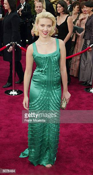 Actress Scarlett Johansson poses for a picture while attending the 76th Annual Academy Awards at the Kodak Theater on February 29, 2004 in Hollywood,...