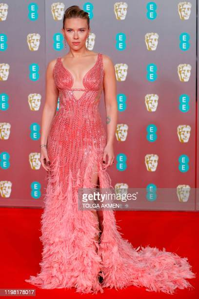 US actress Scarlett Johansson poses on the red carpet upon arrival at the BAFTA British Academy Film Awards at the Royal Albert Hall in London on...