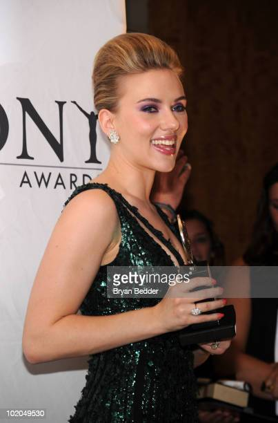 Actress Scarlett Johansson poses with her award for Best Performance by a Featured Actress in a Play at the 64th Annual Tony Awards at The Sports...