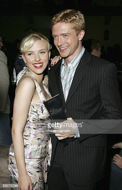 Actress Scarlett Johansson poses with Topher Grace actor at the 4th annual Premiere The New Power event in celebration of the next generation of...