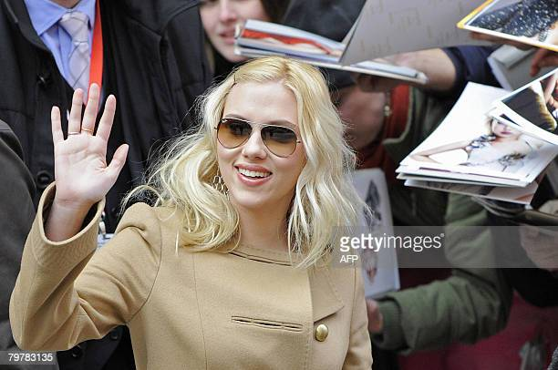 US actress Scarlett Johansson waves as she arrives for a photocall for the movie 'The Other Boleyn girl' by British director Justin Chadwick and...
