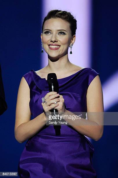 Actress Scarlett Johansson wears a Roland Mouret dress, Van Cleefs and Arpels jewelry and Christian Louboutin shoes as the co-hosts The Nobel Peace...