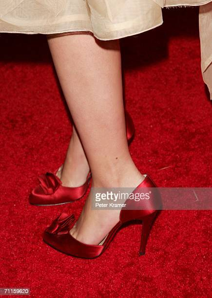 Actress Scarlett Johansson wears red stilettos at the Cartier And Interview Magazine 'Celebrate Love' party at the Cartier Mansion June 8 2006 in New...