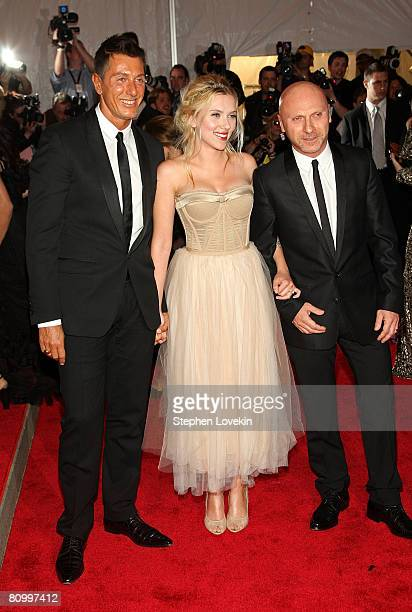 Actress Scarlett Johansson with designers Stefano Gabbana and Domenico Dolce arrive at the Metropolitan Museum of Art Costume Institute Gala...
