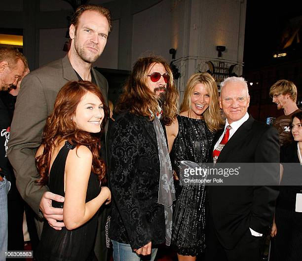 Actress Scout TaylorCompton actor Tyler Mane director/writer Rob Zombie Sheri Moon and actor Malcolm McDowell arrive to the Los Angeles premiere of...