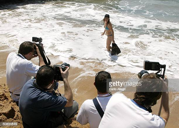 Actress Sean Young is photographed by photographers at a photocall for the film 'Killer Within' during the 57th International Cannes Film Festival...