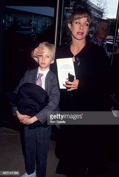 Actress Season Hubley and son Boston Russell attend the Fund for Animals' Fourth Annual Genesis Awards on February 11 1990 at the Beverly Hilton...