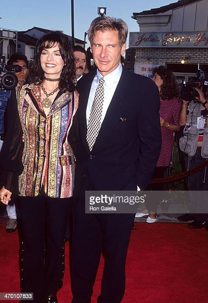Actress Sela Ward and actor Harrison Ford attend The Fugitive Westwood Premiere on July 29 1993 at the Mann Village Theatre in Westwood California